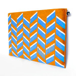 ambette macbook sleeve orange wool felt with white and blue print, $70 available at the Colour Box Studio Summer Pop Up Shop